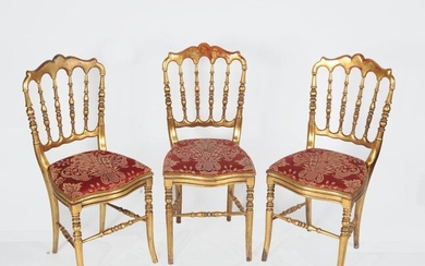 Suite of three giltwood chairs, spindle backrest, Napoleon III style....
