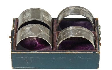 TWO PAIRS OF DEMI BROTHERS STERLING SILVER NAPKIN RINGS IN BOX