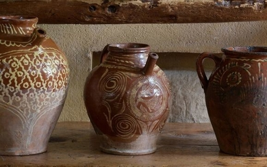 Three red earthenware potteries with white engobe decoration...