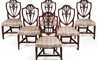 VERY FINE AND RARE SET OF SIX FEDERAL CARVED MAHOGANY SHIELD-BACK SERPENTINE-FRONT SIDE CHAIRS, RHODE ISLAND, CIRCA 1800