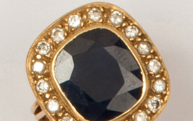 Yellow gold ring set with an oval sapphire...