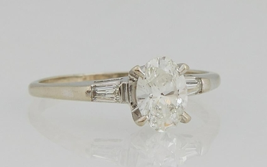 14K White Gold Oval Diamond Ring, the central .81 carat