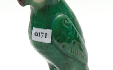 A 19TH CENTURY CHINESE GREEN GLAZED PORCELAIN PARROT (SMALL)