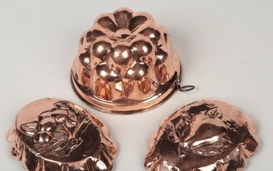 A 19th century copper jelly mould and a pair of oval fruit m...