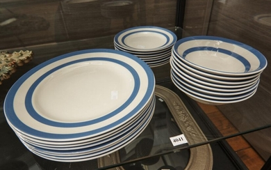 A BLUE AND WHITE CORNISHWARE PART DINNER SERVICE FOR EIGHT COMPRISING EIGHT DINNER PLATES, EIGHT BOWLS AND EIGHT SIDE PLATES, LEONAR...