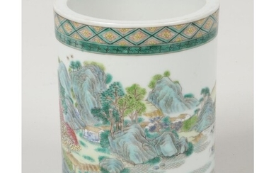 A Chinese famille verte brush pot. Decorated with a continui...