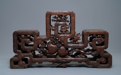 A Chinese finely carved wooden display stand, 19th...