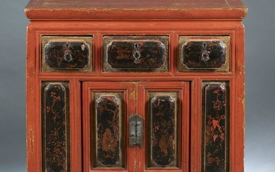 A Chinese red painted with lacquer panels cabinet.