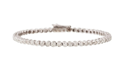 A DIAMOND LINE BRACELET, the brilliant cut diamonds collet s...