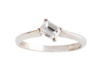 A DIAMOND SOLITAIRE RING, of cross over design, set with an ...