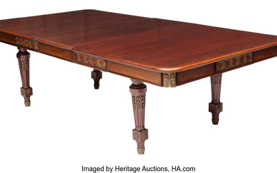 A French Gilt Bronze Mounted Dining Table with One Leaf (19th century)