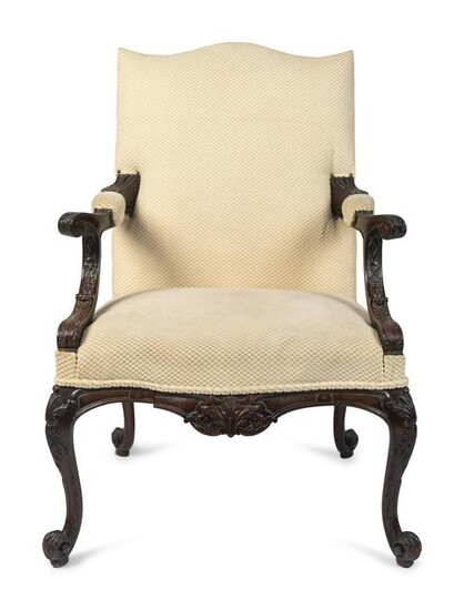A George III Style Carved Mahogany Library Armchair