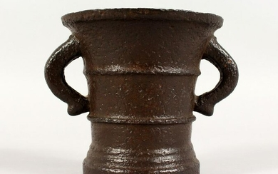 A LATE 17TH/EARLY 18TH CENTURY CAST IRON TWIN-HANDLED
