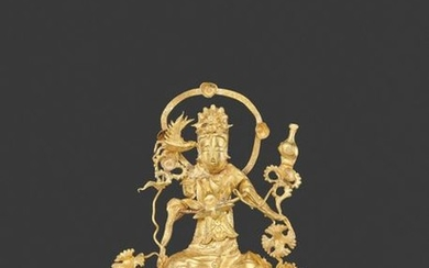 A LIAO DYNASTY GOLD REPOUSSÉ 'GUANYIN' FILIGREE ORNAMENT...