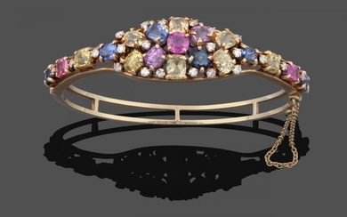 A Multi-Gemstone Cluster Bangle, the cluster set throughout with vari-shaped...