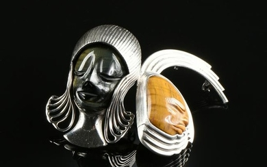 A PAIR OF MEXICAN STERLING SILVER AND TIGER'S EYE MASK