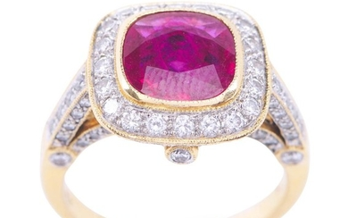 A RUBY AND DIAMOND RING - Featuring a cushion cut ruby weighing an estimated 1.84cts, within a diamond set border, shoulders and gal...