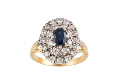 A SAPPHIRE AND DIAMOND CLUSTER RING, the oval sapphire to a ...