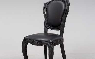 A 'Smoke dining chair' by Maarten Baas for Moooi.
