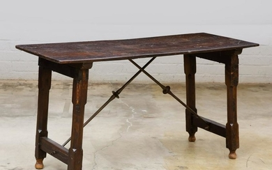 A Spanish Baroque style iron & wood library table