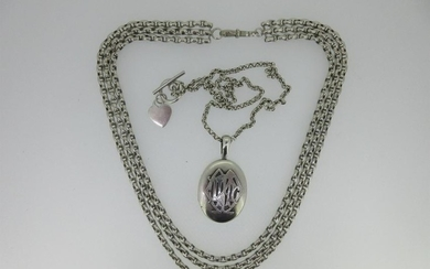 A Victorian silver locket together with a three row