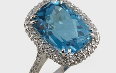 A blue topaz, diamond, and eighteen karat white gold