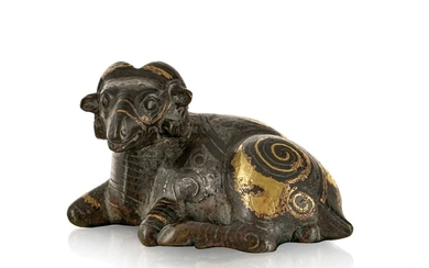 A bronze figure of a reclining ram, China, probably Song dynasty, silver and gilt spiral decorations, 8,5 cm long, C.T. LOO & Cie card