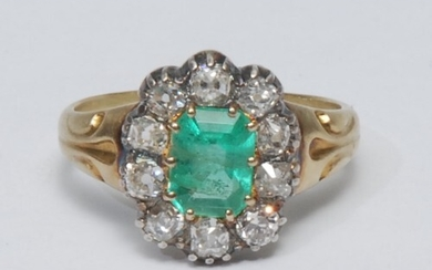 A diamond and emerald cluster ring, central octagonal cut em...