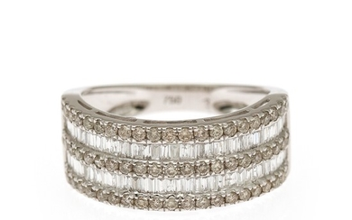 A diamond ring set with numerous brilliant-cut, trapez-cut, and baguette-cut diamonds, mounted in 18k white gold. Size 52.