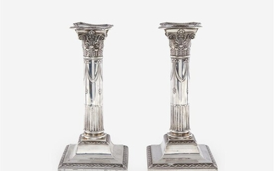 A pair of Edward VII weighted sterling silver candlesticks...