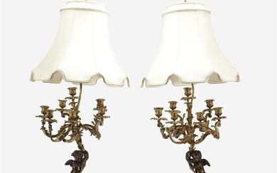 A pair of Louis XV style gilt and patinated...