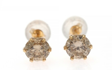 A pair of diamond ear studs each set with a brilliant-cut diamond weighing a total of app. 1.00 ct., mounted in 18k gold. (2)