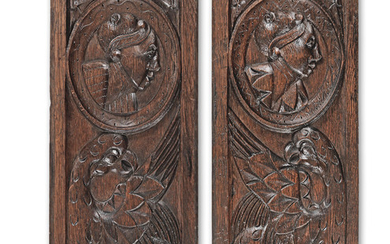 A pair of mid-16th century carved oak 'Romayne'-type panels, circa 1530-60