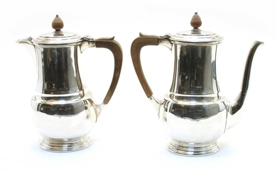 A silver coffee pot and water pot