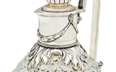 A silver-mounted cut-glass claret jug