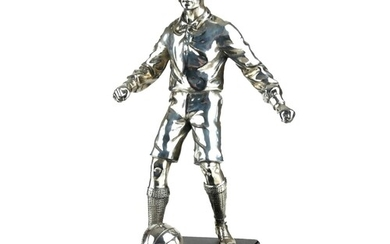 AN EARLY 20TH CENTURY SILVER PLATED STATUE OF A FOOTBALLER. ...