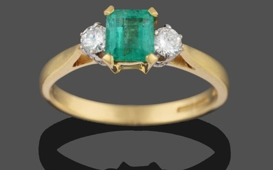 An 18 Carat Gold Emerald and Diamond Three Stone Ring,...