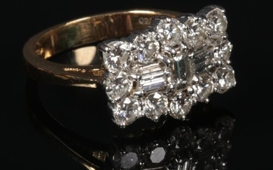 An 18 carat gold diamond cluster ring. Set with three baguet...