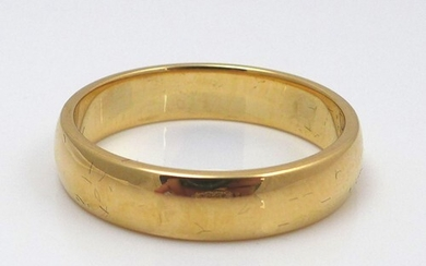 An 18ct yellow gold wedding band, maker LW, size V/W, 7.8g, ...
