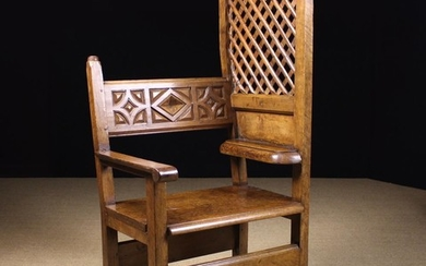An 18th Century Spanish Walnut Confessional Chair. The carved & moulded back bar having a plain upri