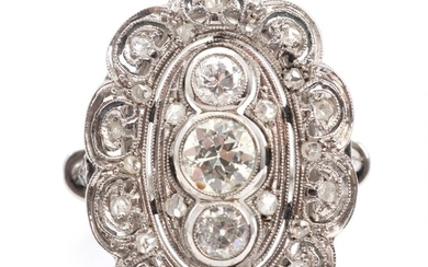 An Art déco diamond ring set with three old mine-cut diamonds and numerous smaller rose-cut diamonds, mounted in 18k white gold. Size 51. Circa 1920.