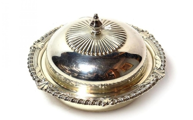 An Elizabeth II silver butter-dish, cover and liner, by C....