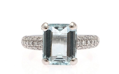An aquamarine and diamond ring set with an emerald-cut aquamarine, flanked by numerous brilliant-cut diamonds, mounted in 18k white gold. Size 54.