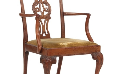 An early George III mahogany armchair with claw-and-ball-feet. Loose seat. England, ca. 1760.