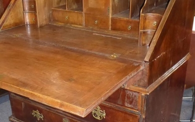 An early to mid-18th century walnut writing bureau; the...