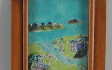Antique Chinese porcelain relief plaque in display