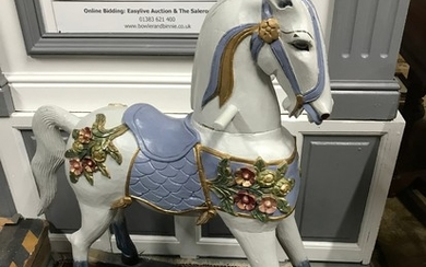 Antique hard wood ornate carved rocking horse. Painted in a ...