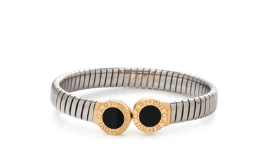 BVLGARI, STEEL, YELLOW GOLD AND ONYX 'TUBOGAS' CUFF BRACELET