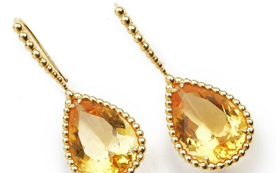 """Boucheron: A pair of citrine ear pendants """"Serpent Bohème"""" each set with a pear-shaped citrine weighing a total of app. 19.75 ct., mounted in 18k gold. Case."""