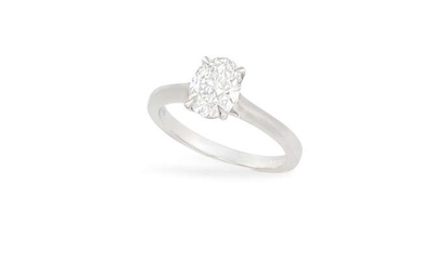 Description A DIAMOND SINGLE-STONE RING The oval-shaped diamond weighing...